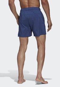 adidas Performance - SOLID TECH SWIM SHORTS - Shorts - blue - 1
