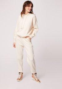 Morgan - HOSEN - Leggings - Trousers - white denim - 1