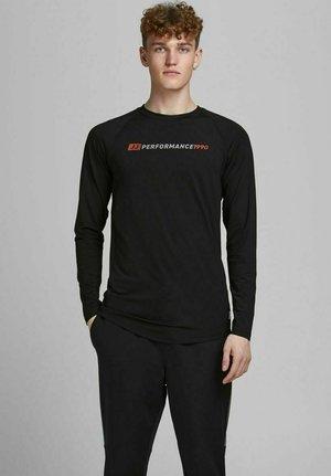 PERFORMANCE - Long sleeved top - black