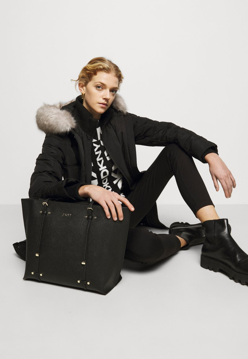 DKNY - BO TOTE SAFFIANO - Handbag - black/gold-coloured