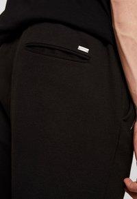 Tigha - ALEKO - Pantalon classique - black - 4