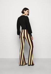 Stieglitz - BINDI FLARED - Trousers - chai - 2