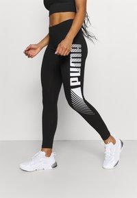 Puma - GRAPHIC LEGGINGS - Collants - black - 0