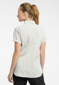 Haglöfs - IDUN SS SHIRT - Button-down blouse - soft white flower - 1