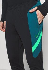 Nike Performance - DRY ACADEMY PANT  - Tracksuit bottoms - black/dark teal green/green strike - 4