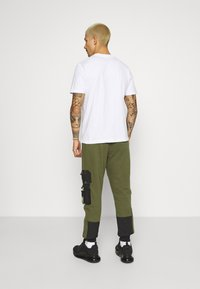 STAPLE PIGEON - TACTICAL - Tracksuit bottoms - olive - 2