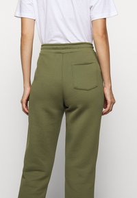 Holzweiler - GABBY TROUSER - Tracksuit bottoms - army - 3