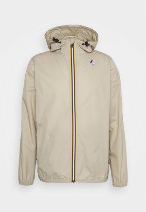 LE VRAI CLAUDE UNISEX - Waterproof jacket - beige