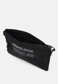 Versace Jeans Couture - UNISEX - Across body bag - black - 4