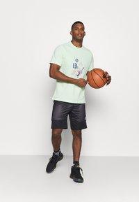 adidas Performance - SPEED REVERSIBLE SHORTS - Sports shorts - black - 1
