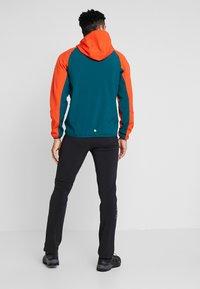 Regatta - AREC  - Soft shell jacket - orange/teal - 2