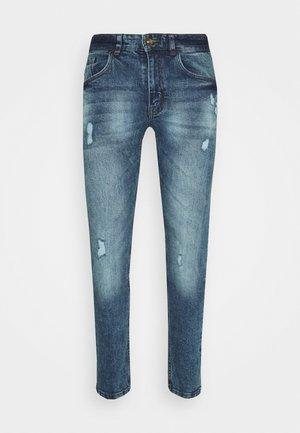 RRSTOCKHOLM DESTROY - Slim fit jeans - vintage denim