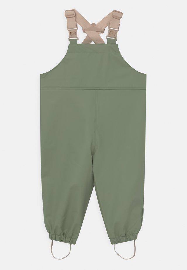 RUBI UNISEX - Rain trousers - oil green