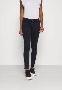 Diesel - SLANDY-LOW-ZIP - Jeans Skinny Fit - dark blue - 0