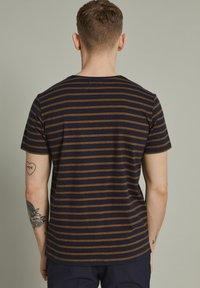 Matinique - MAJERMANE - Print T-shirt - buckthorn yellow - 2