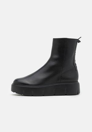 BUSTER - Platform ankle boots - schwarz