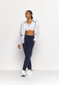 Under Armour - TRICOT PANT - Tracksuit bottoms - midnight navy - 1