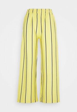 RONNY PANTS - Teplákové kalhoty - lemon multi