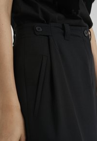McQ Alexander McQueen - LOOSE PANTS - Trousers - black - 4