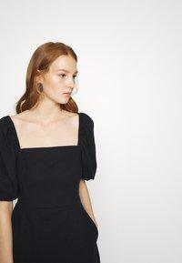 Abercrombie & Fitch - SMOCKED MINI - Day dress - black - 5