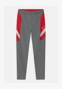 Nike Performance - DRY ACADEMY - Tracksuit bottoms - smoke grey/university red/darkk smoke grey - 0