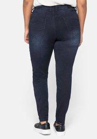 Sheego - Slim fit jeans - blue black denim - 2