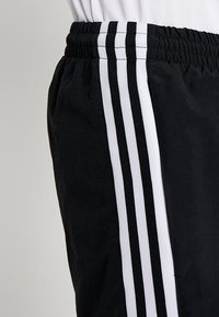 adidas Originals - LOCK UP - Tracksuit bottoms - black - 5
