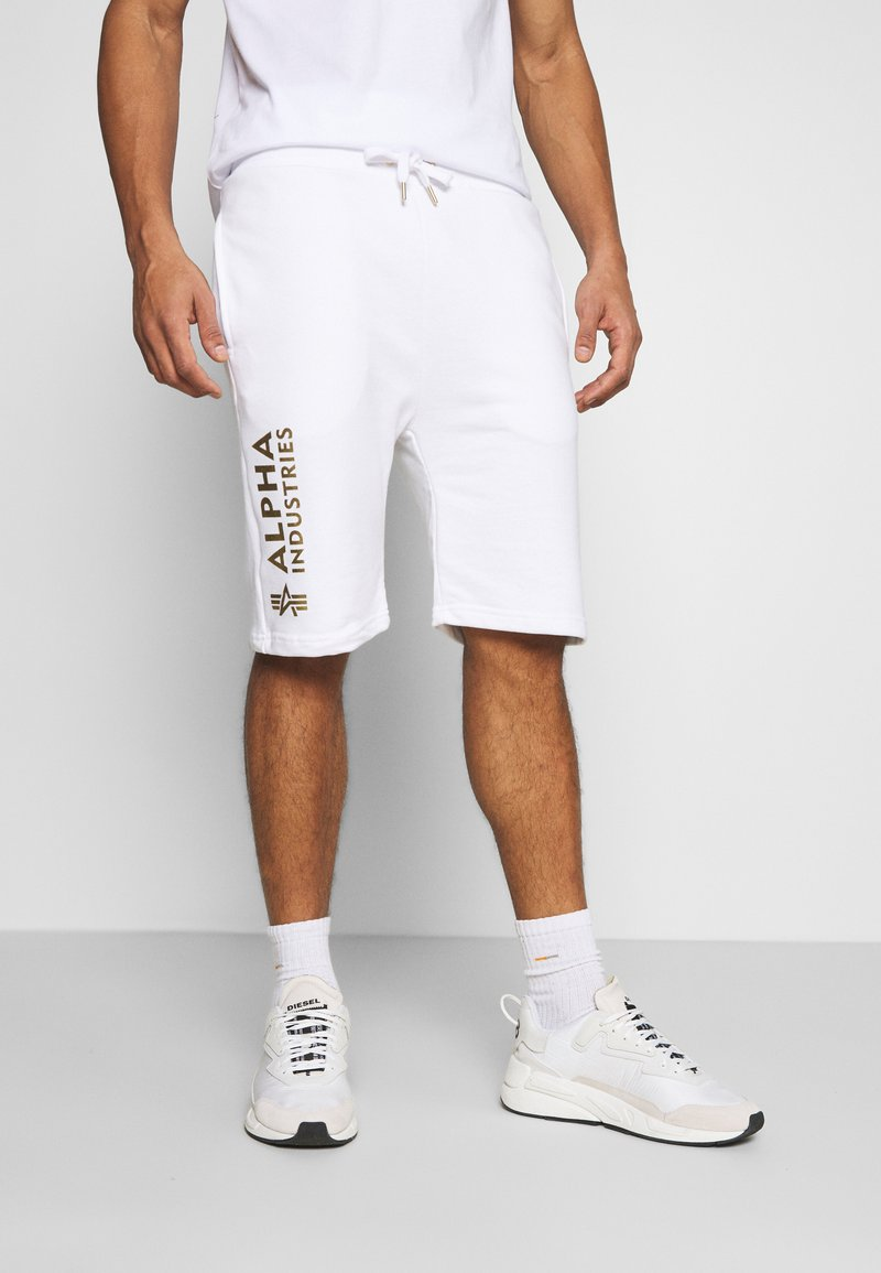 Alpha Industries - BASIC FOIL PRINT - Tracksuit bottoms - white/yellow gold