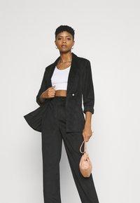 NA-KD - NARROW HEM TROUSERS - Trousers - black - 3