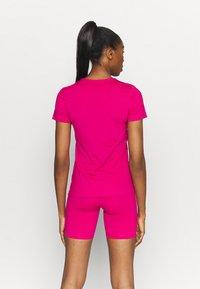 Nike Performance - ALL OVER - Camiseta básica - fireberry/white - 7