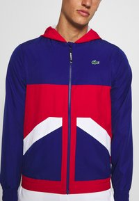 Lacoste Sport - TENNIS JACKET - Training jacket - cosmic/red/white - 5