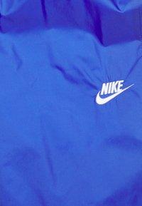 Nike Sportswear - Tracksuit - astronomy blue/university red/white - 2