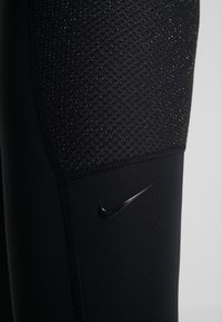 Nike Performance - WARM HOLLYWOOD - Leggings - black/clear - 5