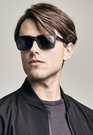 TIOMAN  - Sunglasses - grey