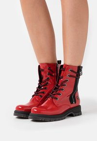 Marco Tozzi by Guido Maria Kretschmer - Lace-up ankle boots - red - 0