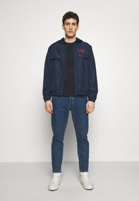 EA7 Emporio Armani - GIUBBOTTO - Training jacket - navy blue - 1