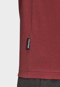 adidas Performance - MUST HAVES BADGE OF SPORT T-SHIRT - Camiseta estampada - red - 7