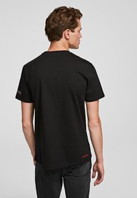 KARL LAGERFELD - LEGEND - Print T-shirt - black - 1
