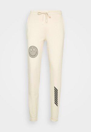 UNISEX  - Pantalon de survêtement - beige
