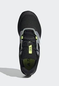 adidas Performance - TERREX TWO FLOW - Stabilty running shoes - savannah/core black/hi-res yellow - 8