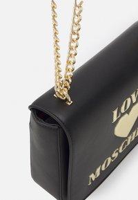 Love Moschino - Across body bag - nero - 5