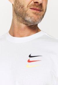 Nike Performance - FC TEE - Print T-shirt - white - 4