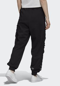 adidas Originals - BELLISTA SPORTS INSPIRED JOGGER PANTS - Pantalones deportivos - black - 1