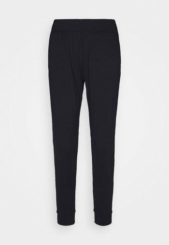 MERIDIAN JOGGERS - Pantalones deportivos - black