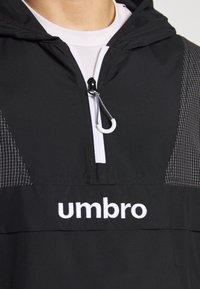 Umbro - DIAMOND REVEAL CAGOULE - Training jacket - black/brilliant white - 4