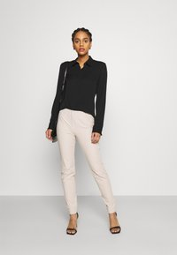 RIANI - DANIELLE - Trousers - beige - 1