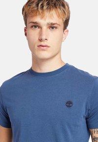 Timberland - Basic T-shirt - dark denim - 4