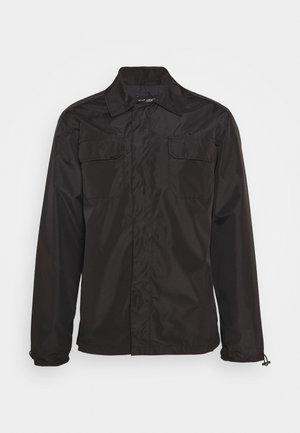 NAOMNI - Leichte Jacke - black