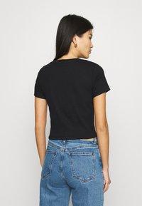 Calvin Klein Jeans - MICRO BRANDING CROP - T-shirt basic - black - 2