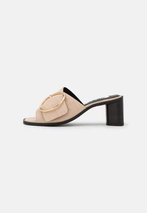 JUSTICE - Heeled mules - bone